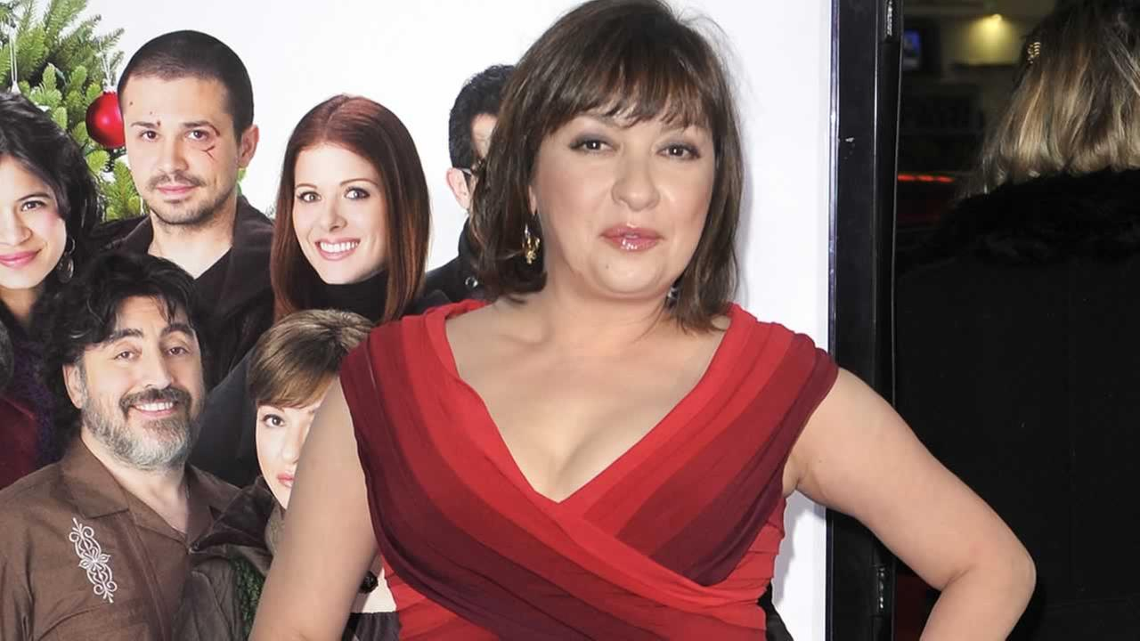 Elizabeth Pena poses as she arrives for the Los Angeles premiere of Nothing Like the Holidays, in Los Angeles.