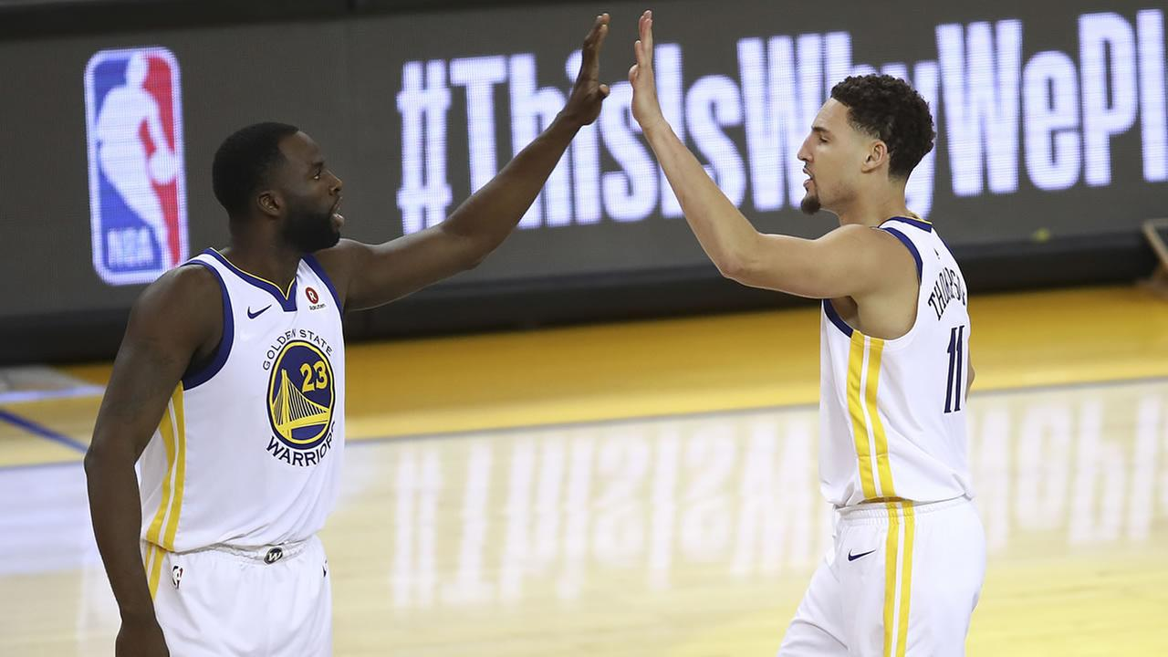 Draymond Green and Klay Thompson high five during Game 6 of the NBA Western Conference Finals on Saturday, May 26, 2018.