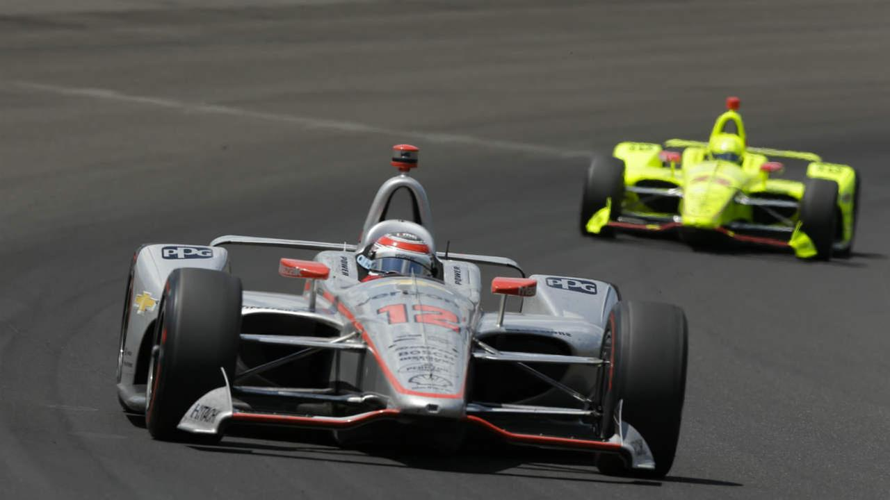Will Power, of Australia, leads Simon Pagenaud, of France, though the first turn during the Indy 500 auto race at Indianapolis Motor Speedway, in Indianapolis Sunday, May 27, 2018.