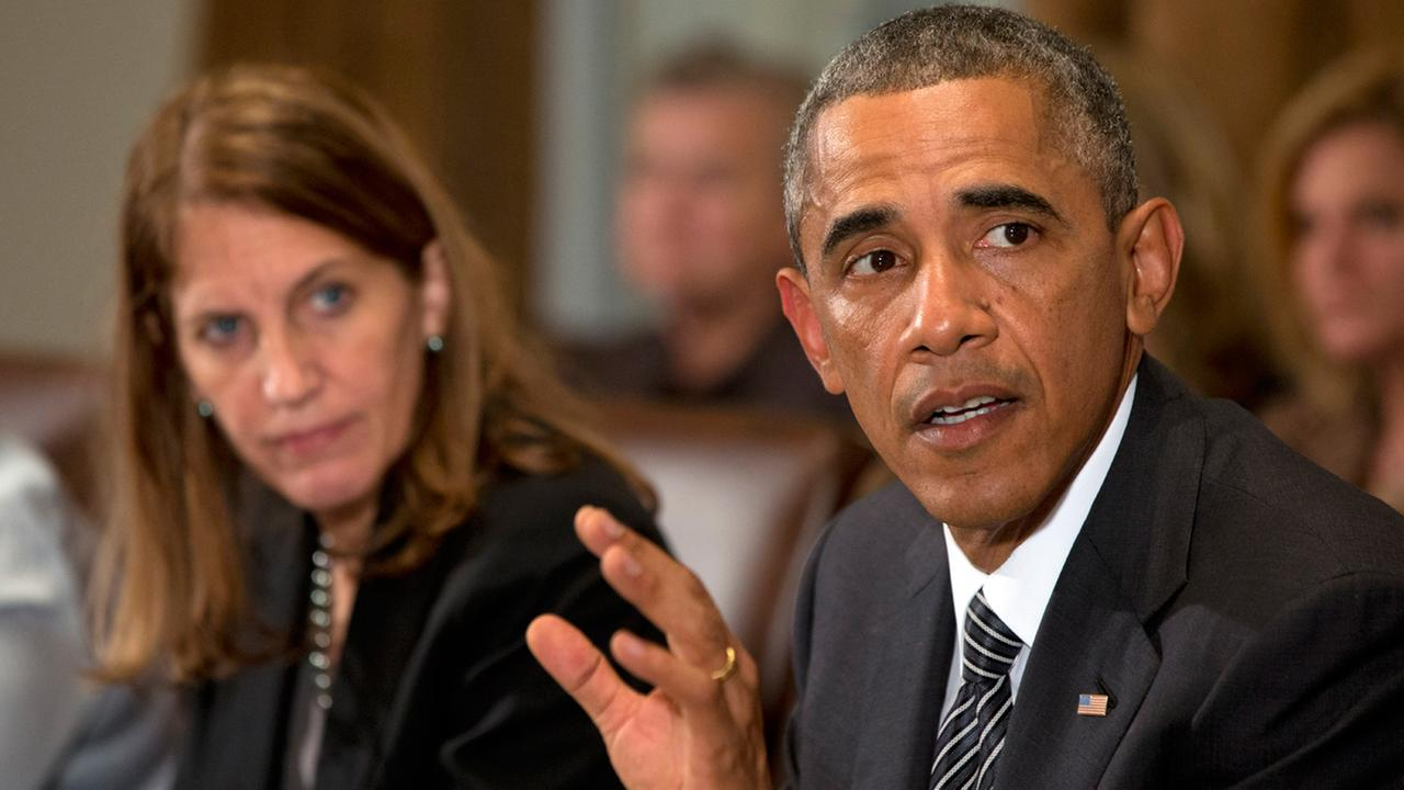 President Obama, right, next to Health and Human Services Secretary Sylvia Burwell, speaks to the media about Ebola during a meeting in the Cabinet Room of the White House.