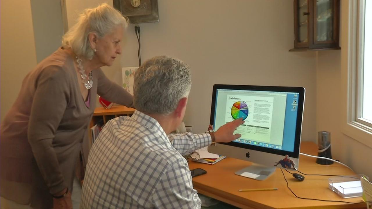 Mitch Tuchman helps his mother, Charlene Tuchman, with her finances in San Francisco.
