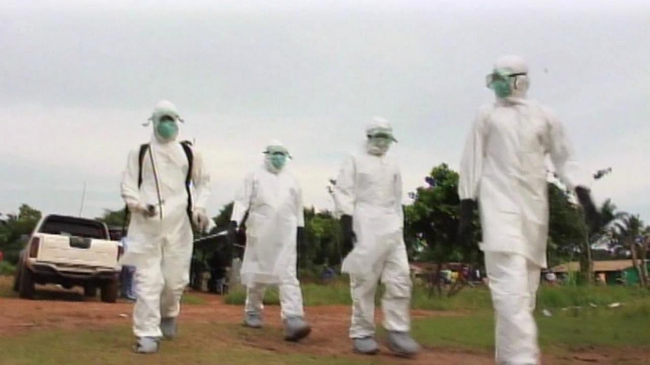 Health care workers battle Ebola in West Africa.