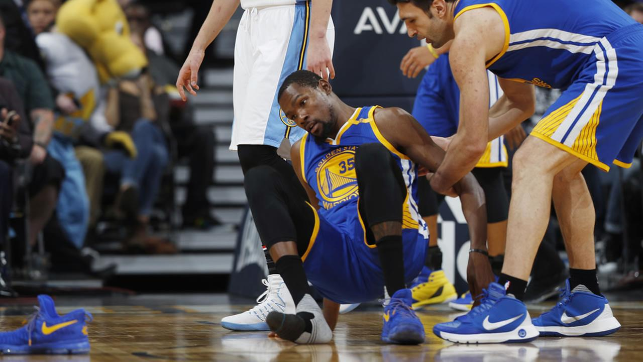 Warriors star Kevin Durant lost his shoe during the second half of an NBA basketball game against the Denver Nuggets Thursday, Nov. 10, 2016, in Denver.