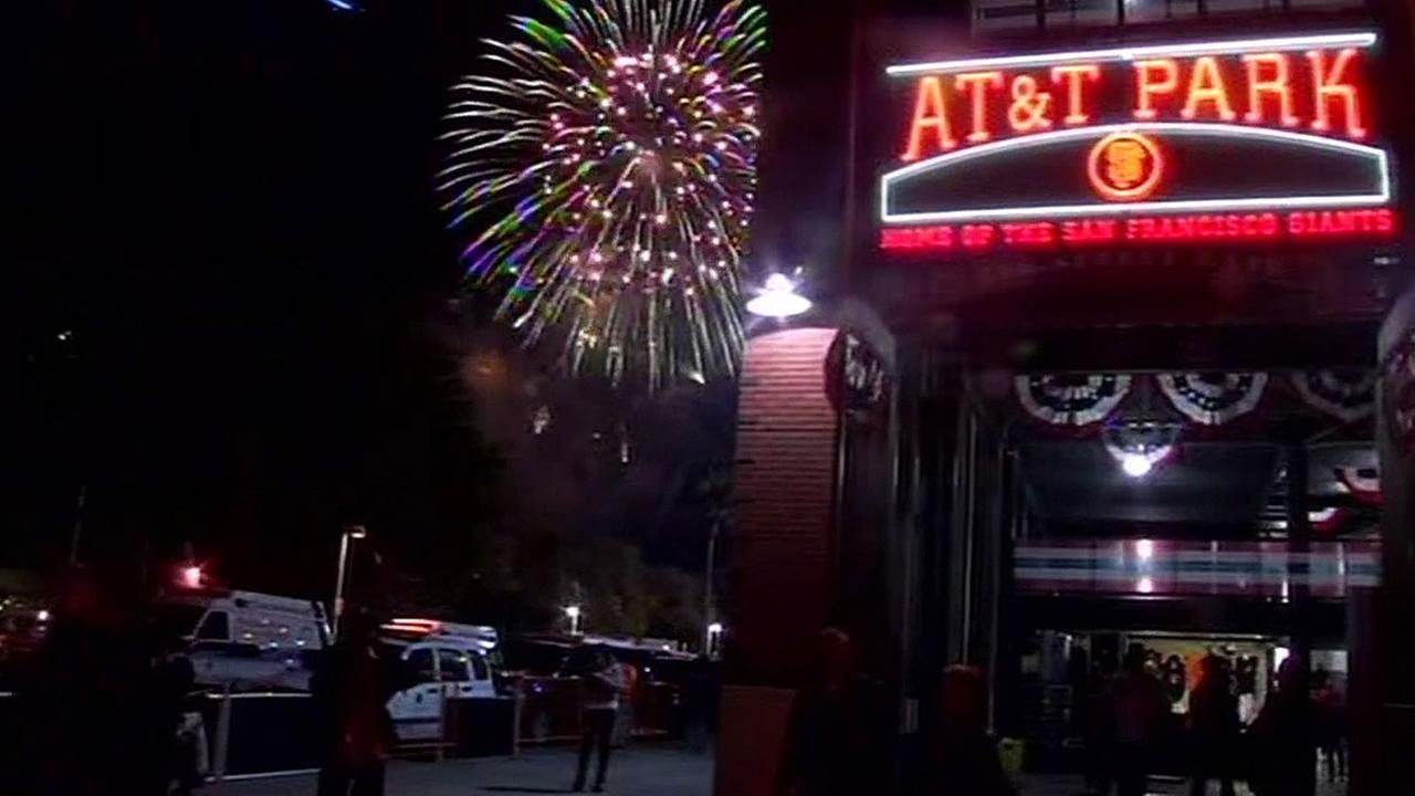 AT&T Park with fireworks going off in the sky