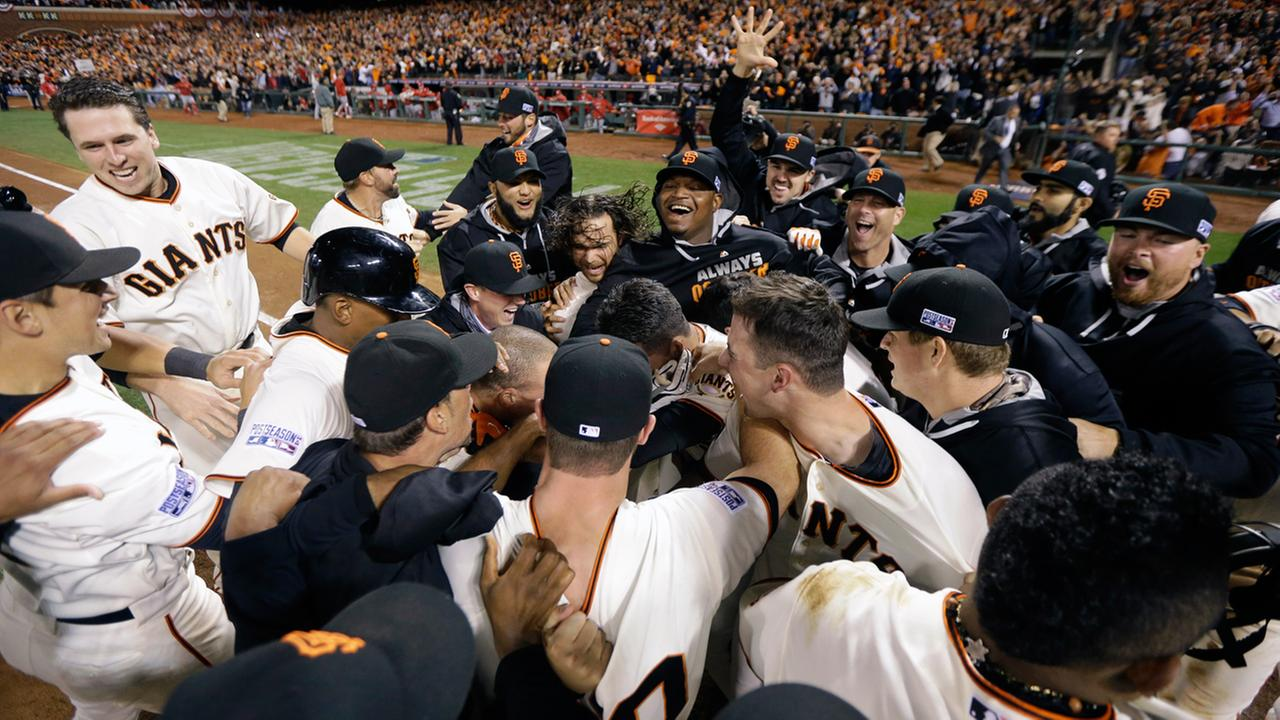 Members of the San Francisco Giants celebrates their win against the St. Louis Cardinals in Game 5 of the National League baseball championship series Thursday, Oct. 16, 2014.
