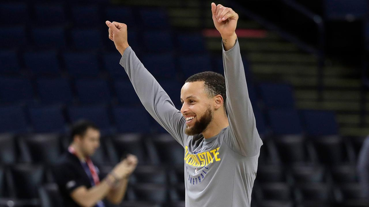 Golden State Warriors Stephen Curry gestures to a teammate during an NBA basketball practice, Wednesday, May 30, 2018, in Oakland, Calif.