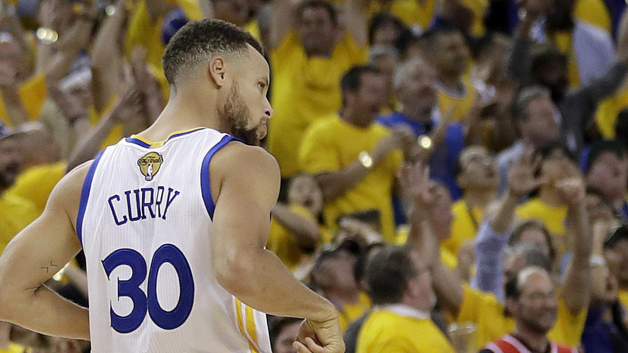 Fans cheer after guard Stephen Curry scored against the Cleveland Cavaliers during Game 2 of basketballs 2017 NBA Finals in Oakland, Calif., June 4, 2017.