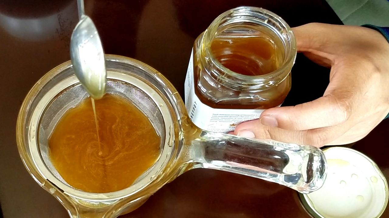 Felicity Chen adds a spoonful of honey infused with cannabis to her traditional Chinese tea. She started making the cannabis honey to help her mom with asthma.