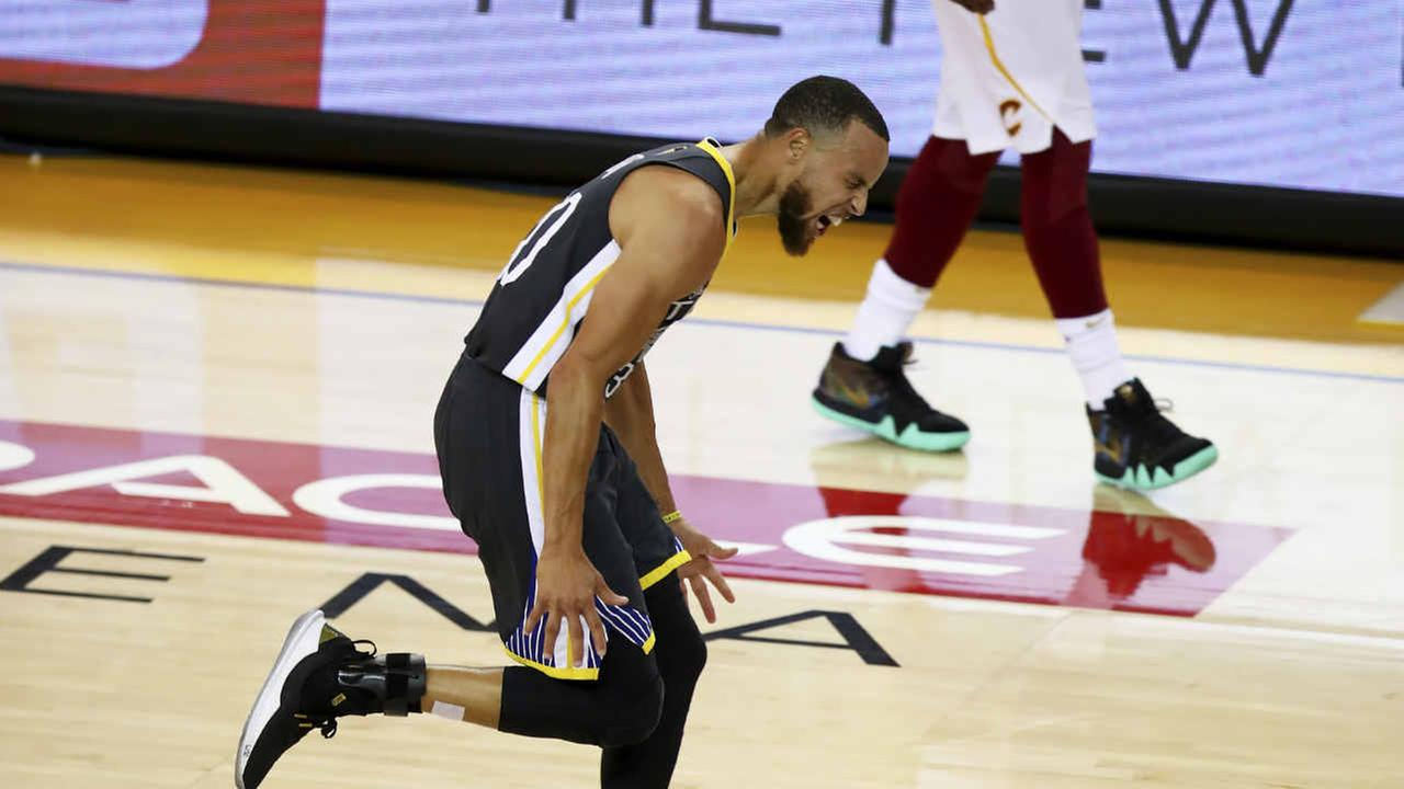 Warriors guard Stephen Curry celebrates after scoring against the Cavaliers during the first half of Game 2 of basketballs NBA Finals in Oakland, Calif., Sunday, June 3, 2018.