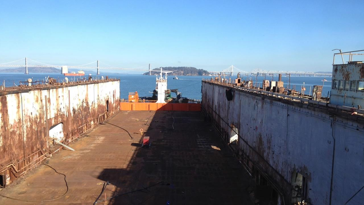Drydock is being lifted out of the San Francisco Bay and onto a vessel to be transported to China.