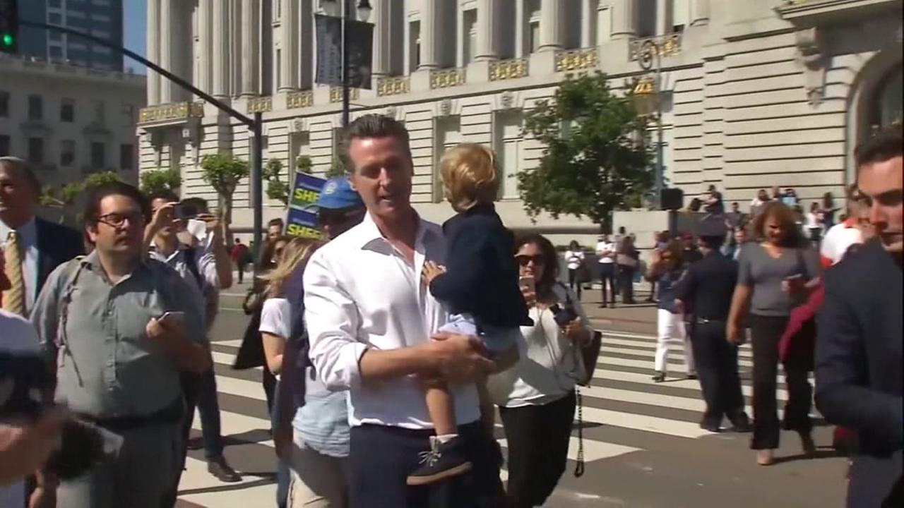 Gavin Newsom votes with his child in San Francisco on Tuesday, June 5, 2018.
