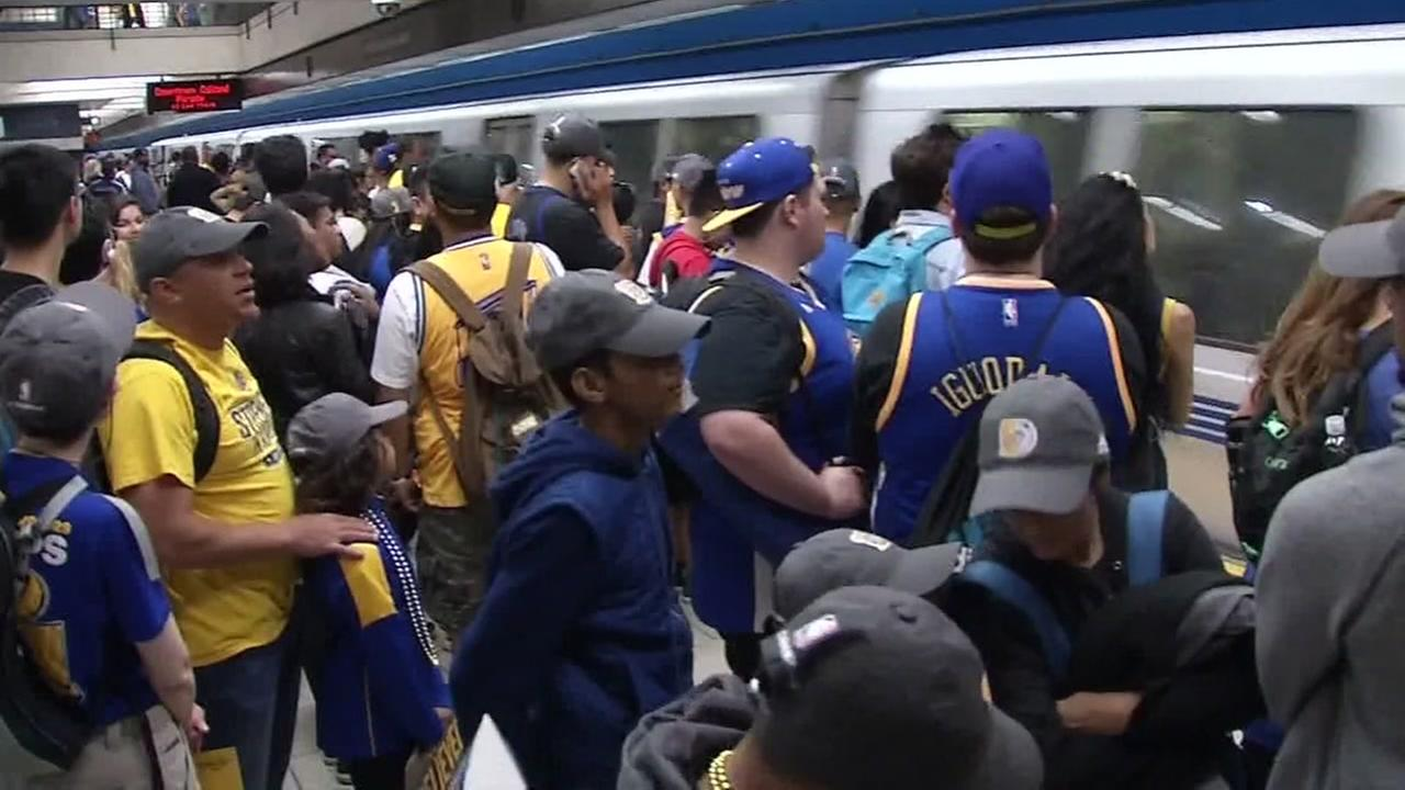 File -- Warriors fans at BART station.