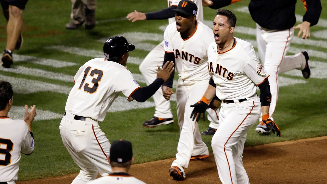 San Francisco Giants Travis Ishikawa reacts after hitting a walk-off three-run home run during the ninth inning of Game 5 of the NLCS.