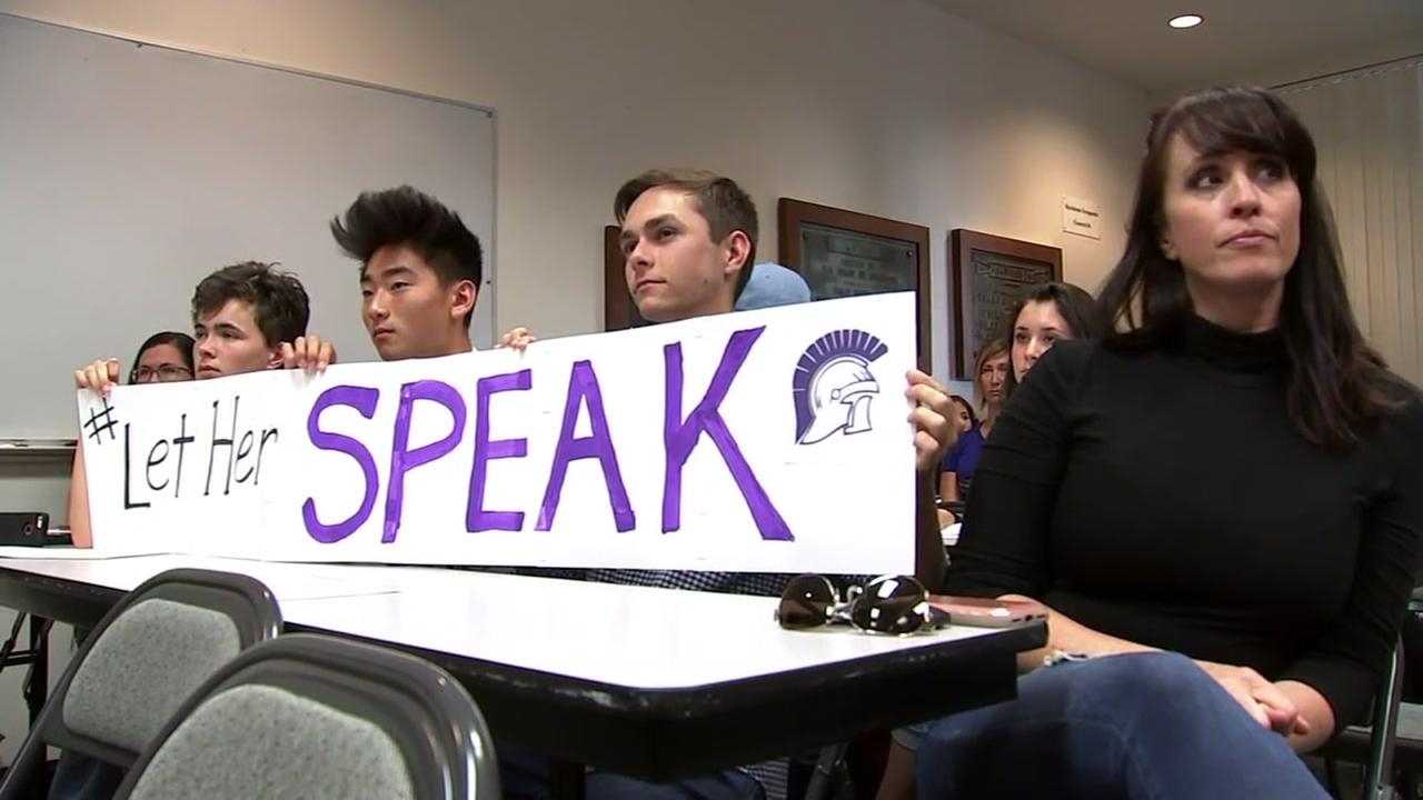 Students are seen holding a sign at a meeting in Petaluma, Calif. on Tuesday, June 12, 2018.