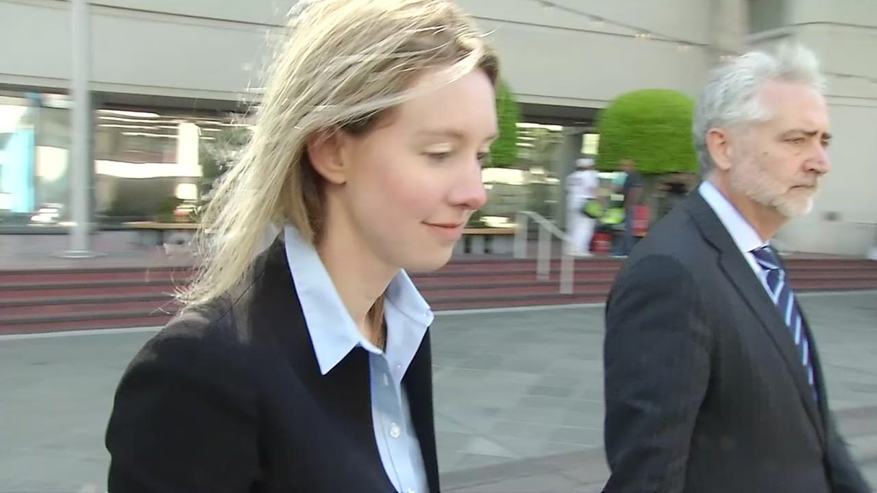 Elizabeth Holmes walks out of a courtroom in the South Bay on Friday, June 15, 2018.