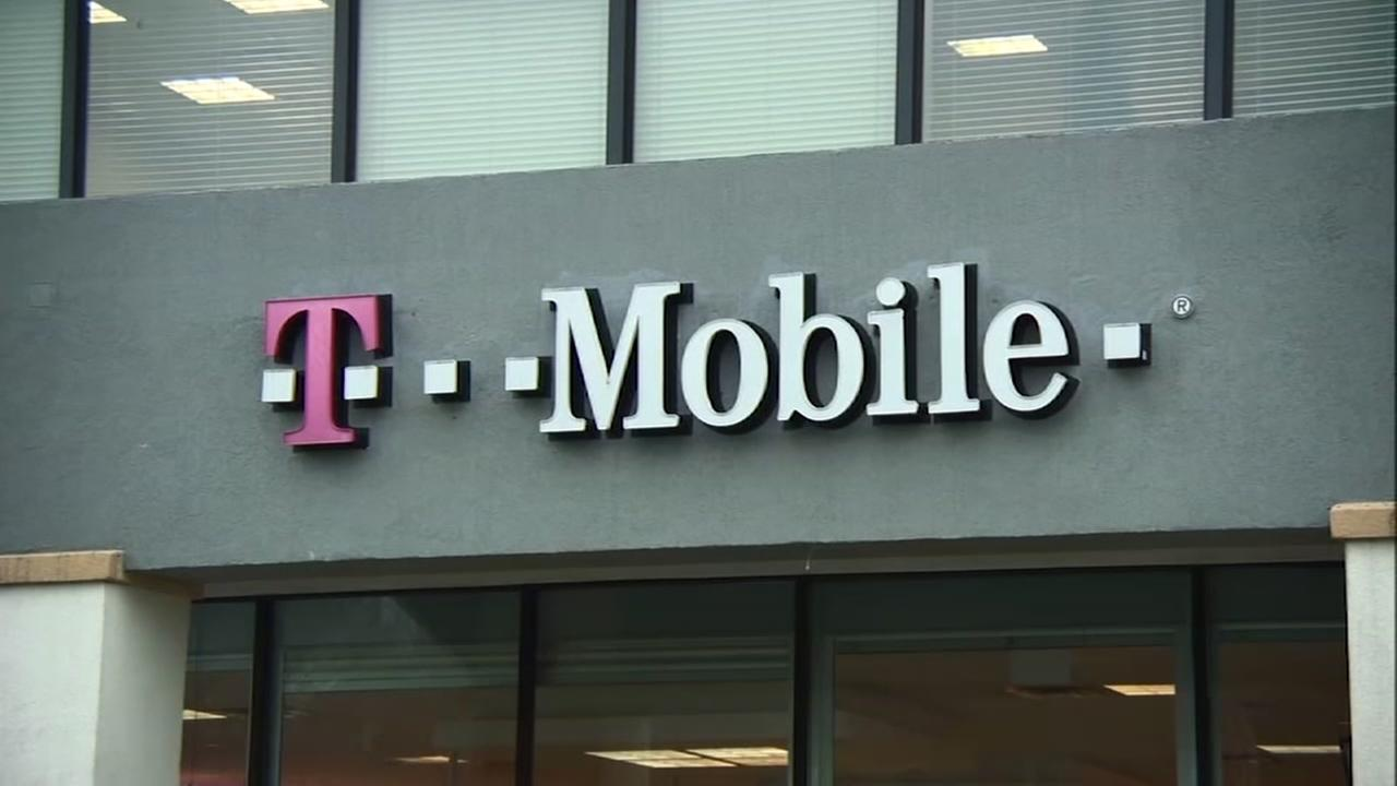 The T-Mobile logo is pictured on a storefront in this undated file photo.