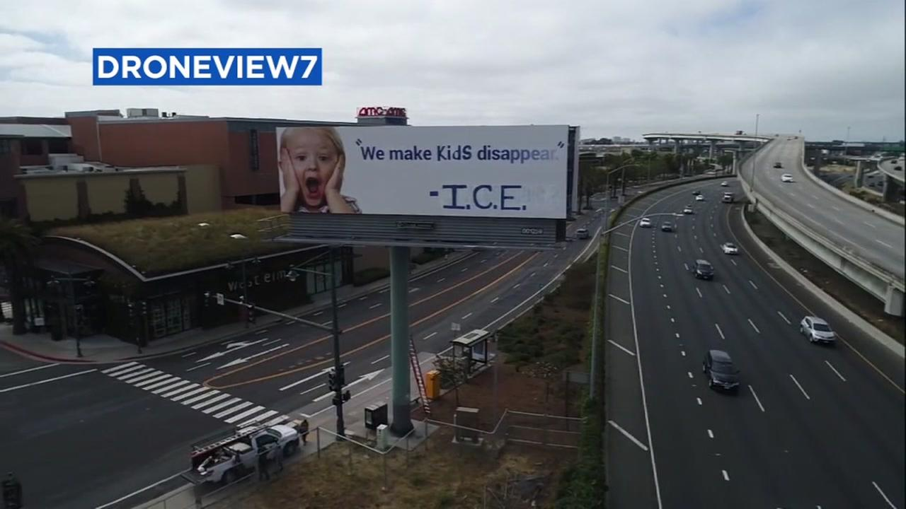 A billboard that was vandalized to make a statement on an immigration policy is seen in Emeryville, Calif. on Thursday, June 21, 2018.