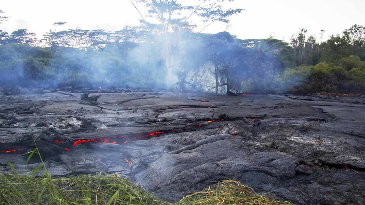 This Oct. 22, 2014 photo shows lava flow slowly moving through thick vegetation as it advances on the town of Pahoa on the Big Island of Hawaii. (AP Photo/U.S. Geological Survey)