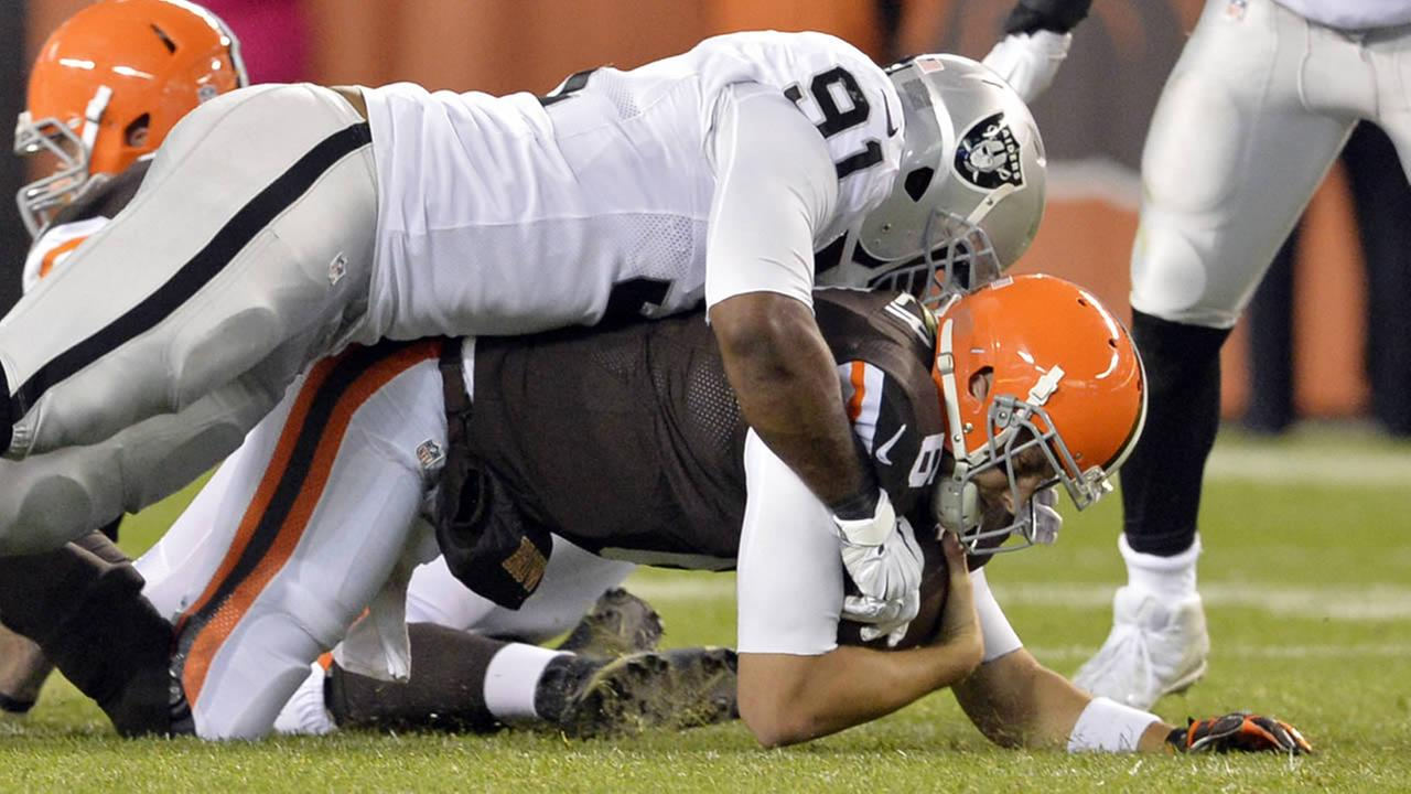 Browns quarterback Brian Hoyer is sacked by Raiders defensive end Justin Tuck (91) in the fourth quarter of a game Sunday, Oct. 26, 2014, in Cleveland. (AP Photo/David Richard)