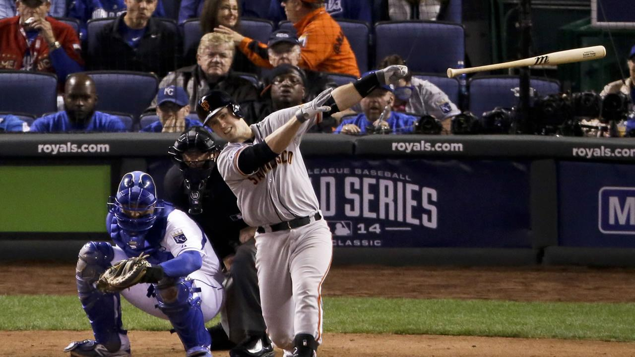 San Francisco Giants Buster Posey loses his by after strike during the sixth inning of Game 6 of baseballs World Series against the Kansas City Royals Tuesday, Oct. 28, 2014.