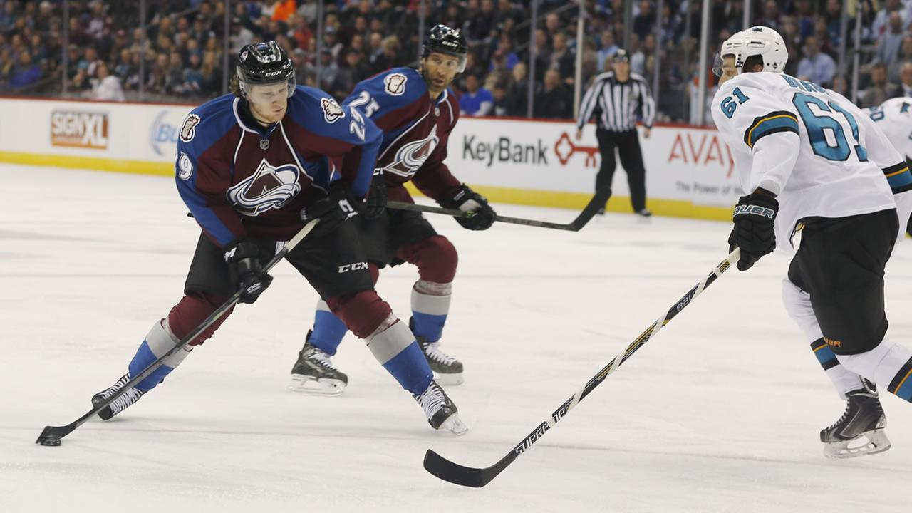 Colorado Avalanche center Nathan MacKinnon takes shot as San Jose Sharks defenseman Justin Braun covers