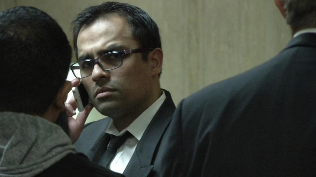 Former RadiumOne CEO Gurbaskh Chahal talks on the phone while in court.