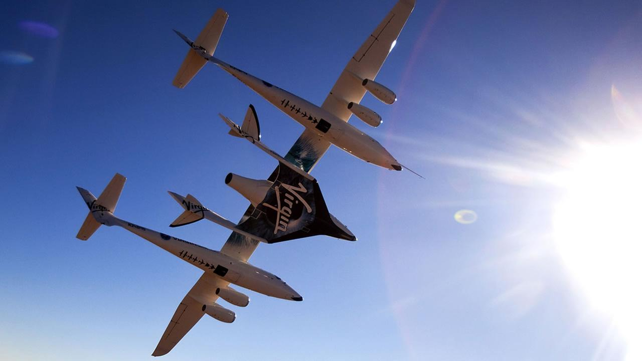 This image provided by Mark Greenberg/Virgin Galactic shows WhiteKnight2 with SpaceShip2 attached, over Mojave, Calif., July 15, 2010.