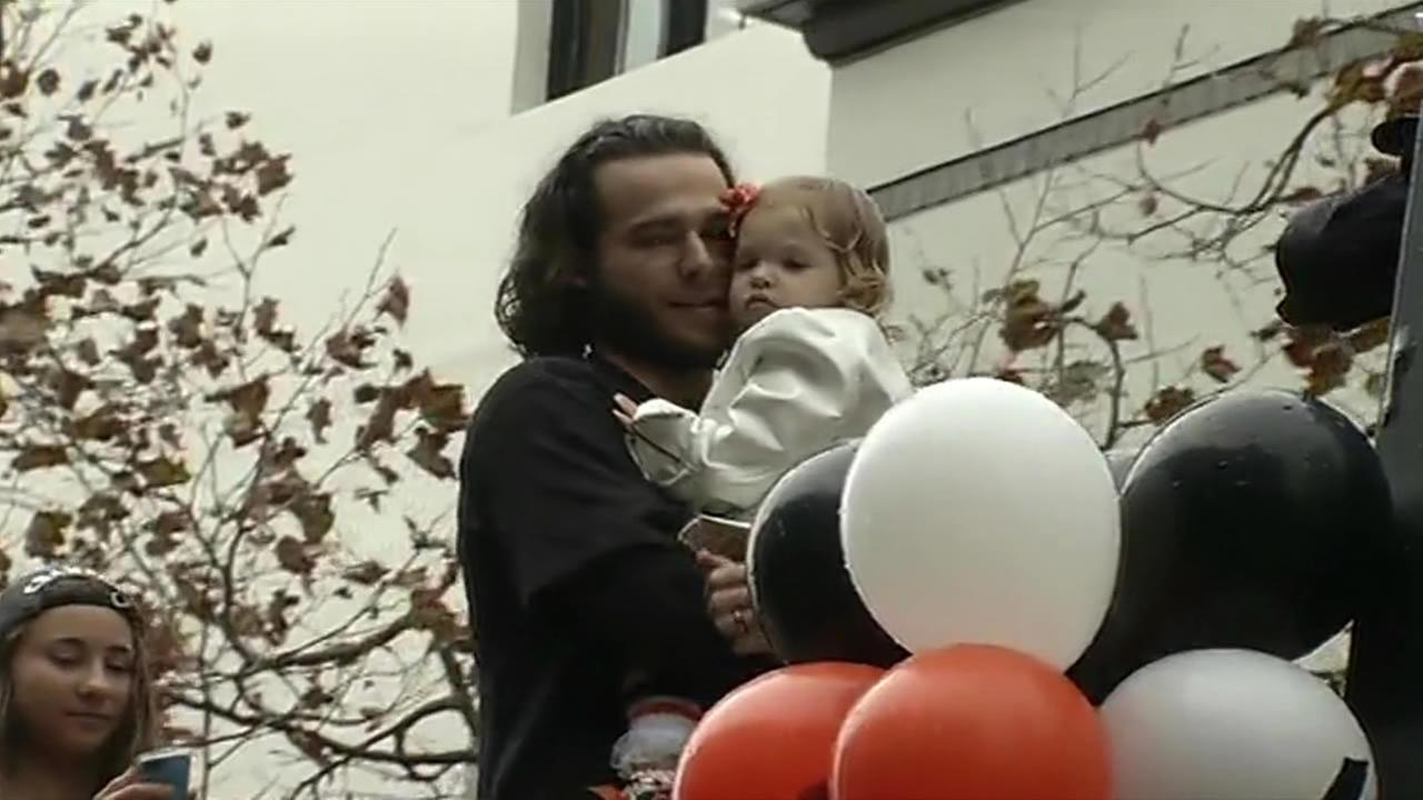 Brandon Crawford celebrating with his daughter by his side during the San Francisco Giants 2014 Victory Parade in San Francisco, October 31, 2014. (ABC7 News)