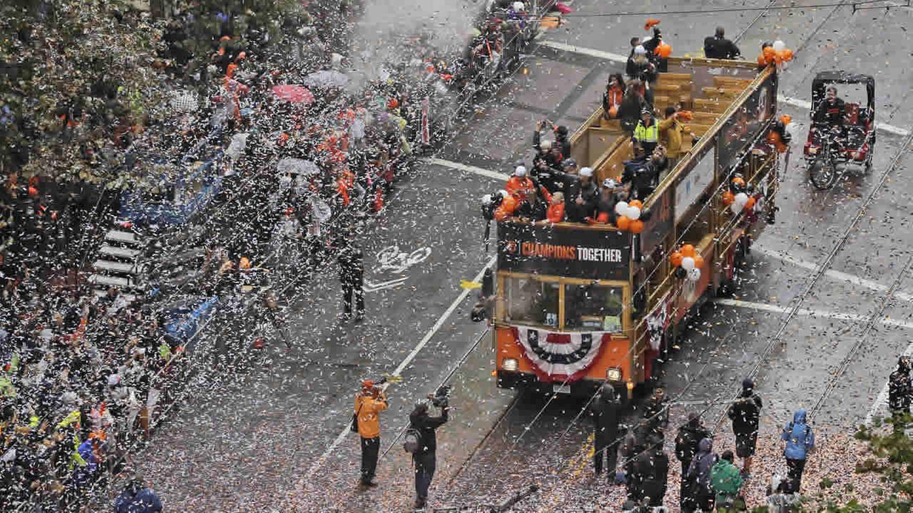 A bus carrying Giants players makes its way down Market Street during a victory parade for the 2014 World Series Champion SF Giants on Oct. 31,2014 in San Francisco.(AP Photo)