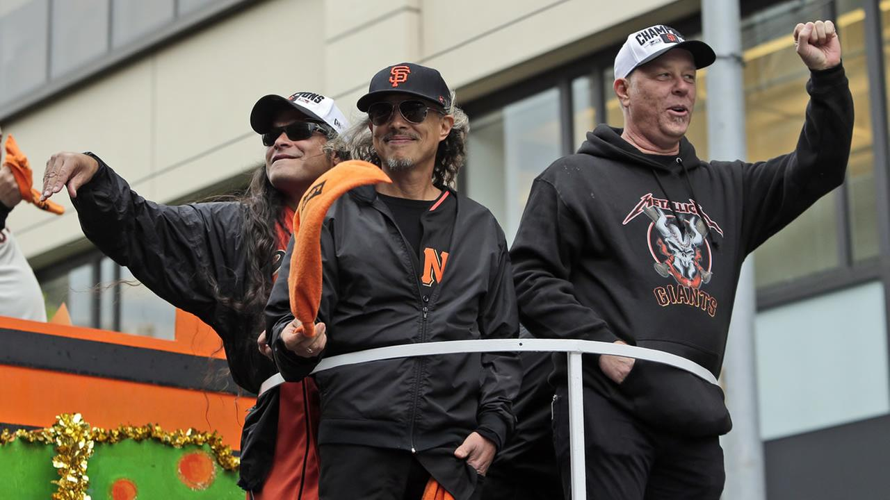 Members of the band Metallica wave to fans during the victory parade for baseballss 2014 World Series Champion SF Giants on Oct. 31, 2014 in San Francisco.(AP Photo)