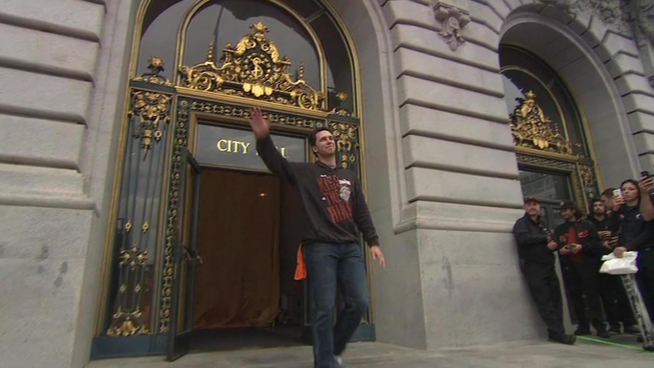Buster Posey waves during a rally at Civic Center Plaza following the San Francisco Giants 2014 Victory Parade in San Francisco, October 31, 2014. (ABC7 News)