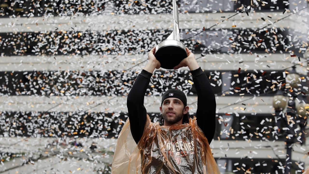 Giants pitcher Madison Bumgarner holds the World Series MVP trophy during the victory parade for the 2014 baseball World Series champions on Oct. 31, 2014  in SF. (AP Photo)