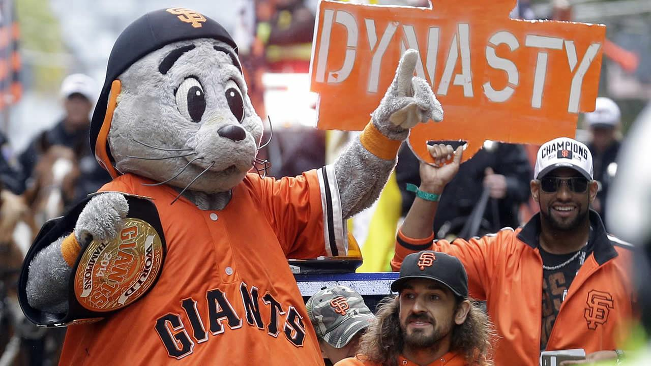 Giants mascot Lou Seal waves to the crowd during the victory parade for the 2014 World Series Champions San Francisco Giants on Oct. 31, 2014 in SF. (AP Photo/Jeff Chiu)