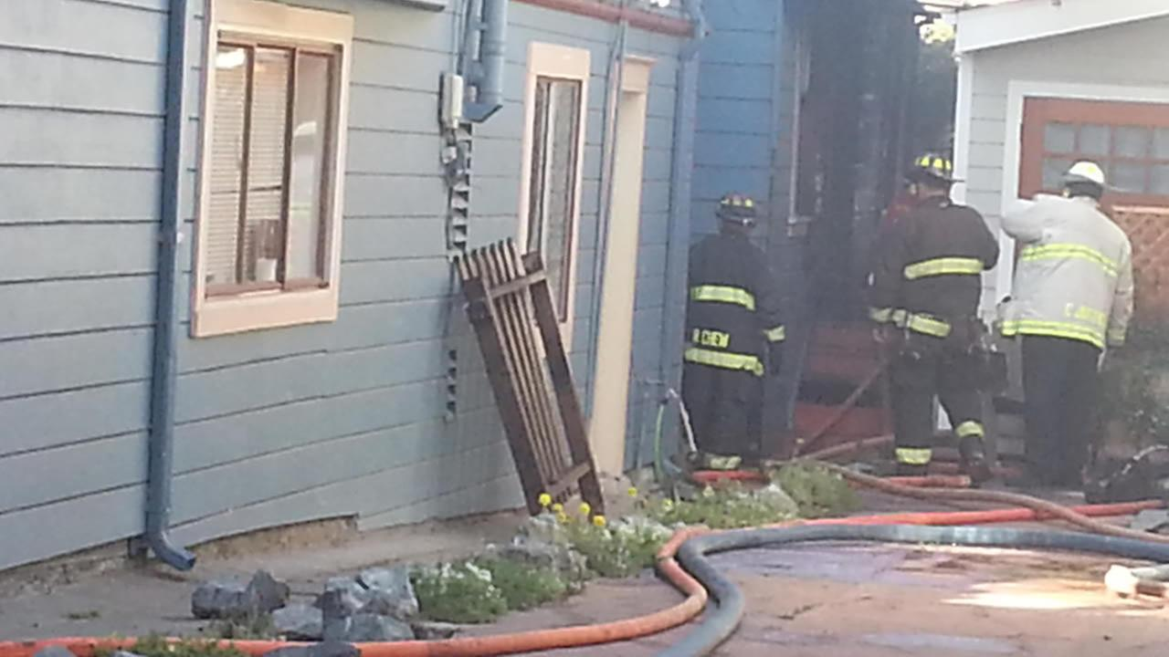 Crews control one-alarm house fire in Oakland.