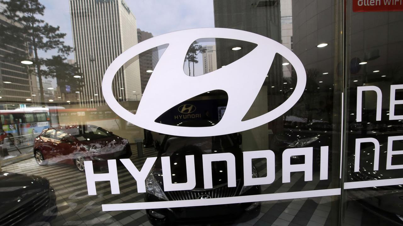 The logo of Hyundai Motor Co. is displayed at the automakers showroom in Seoul, South Korea, Thursday, Jan. 23, 2014.(AP Photo/Lee Jin-man)
