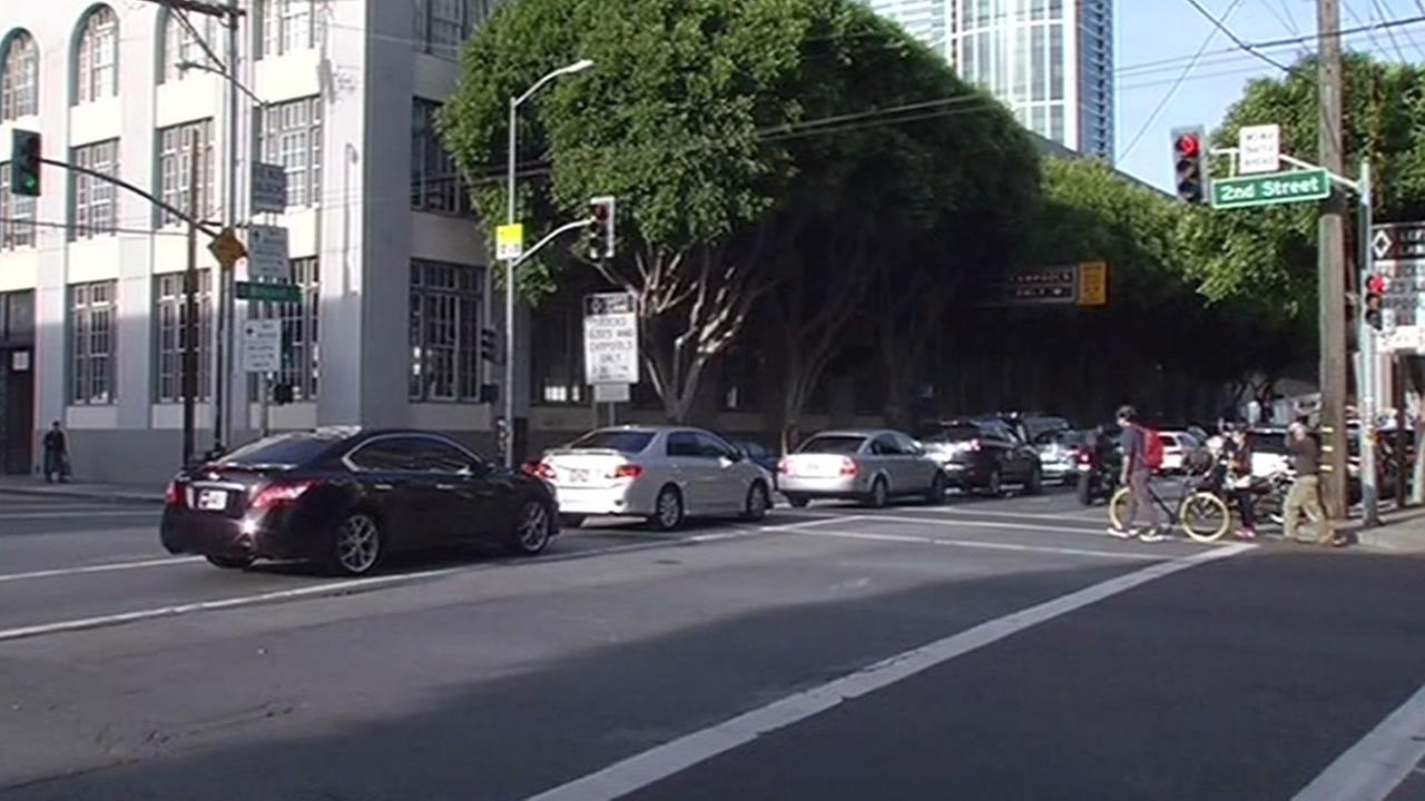 two cars in San Francisco are blocking the box at in intersection