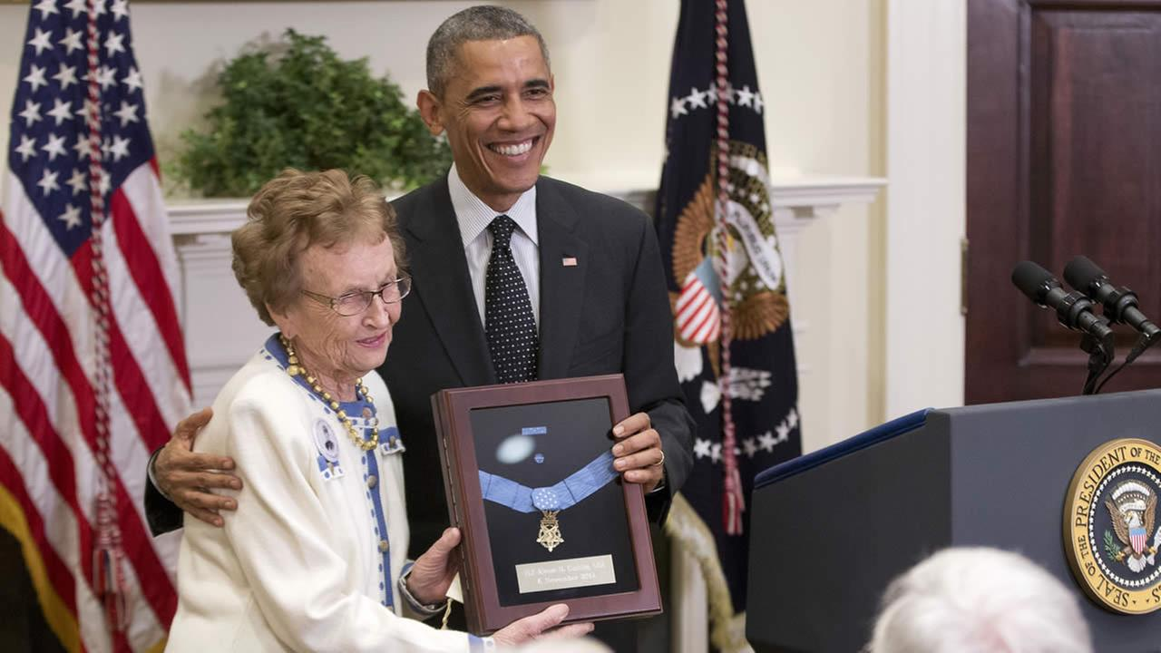 President Obama stands with Helen Loring Ensign, 85, from Palm Desert, Calif., as he awards the Medal of Honor posthumously to Army First Lt. Alonzo H. Cushing, Nov. 6, 2014, during a ceremony in the White House.  (AP Photo/Pablo Martinez Monsivais)