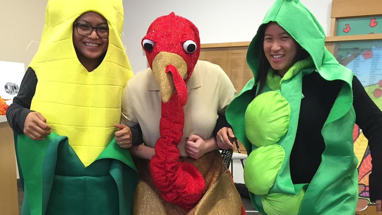 Volunteers wear costumes at the Second Harvest Food Bank
