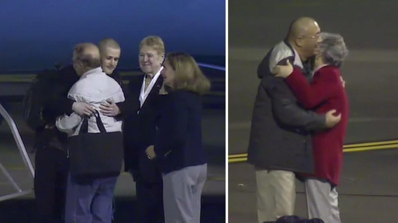 Matthew Miller and Kenneth Bae greet loved ones after landing at a Washington state military base.