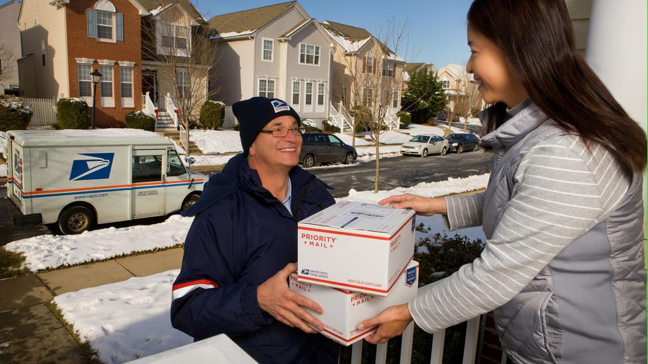 USPS carrier delivering packages