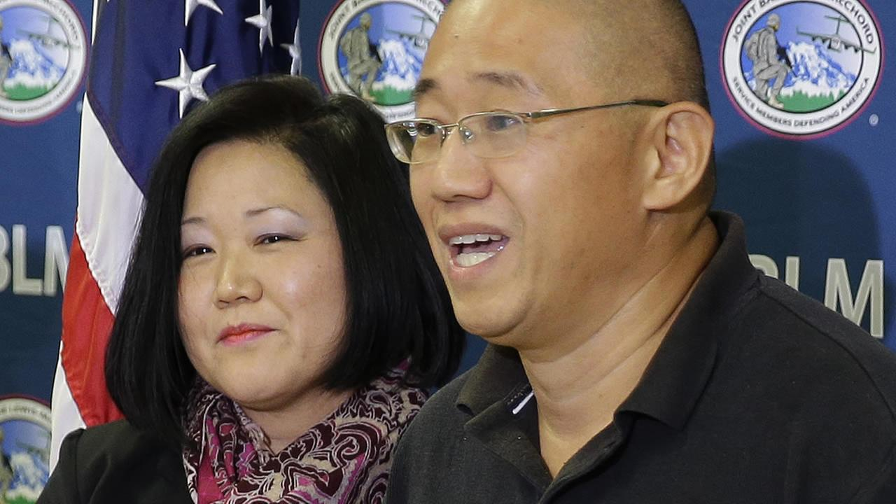 Kenneth Bae who had been held in North Korea since 2012, talks to reporters after he arrived Saturday, Nov. 8, 2014, at Joint Base Lewis-McChord, Wash. (AP Photo/Ted S. Warren)