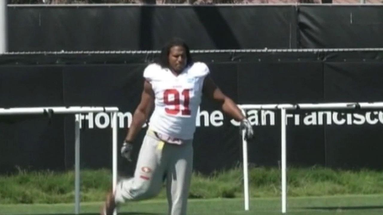 Ray McDonald stretches on the 49ers practice field