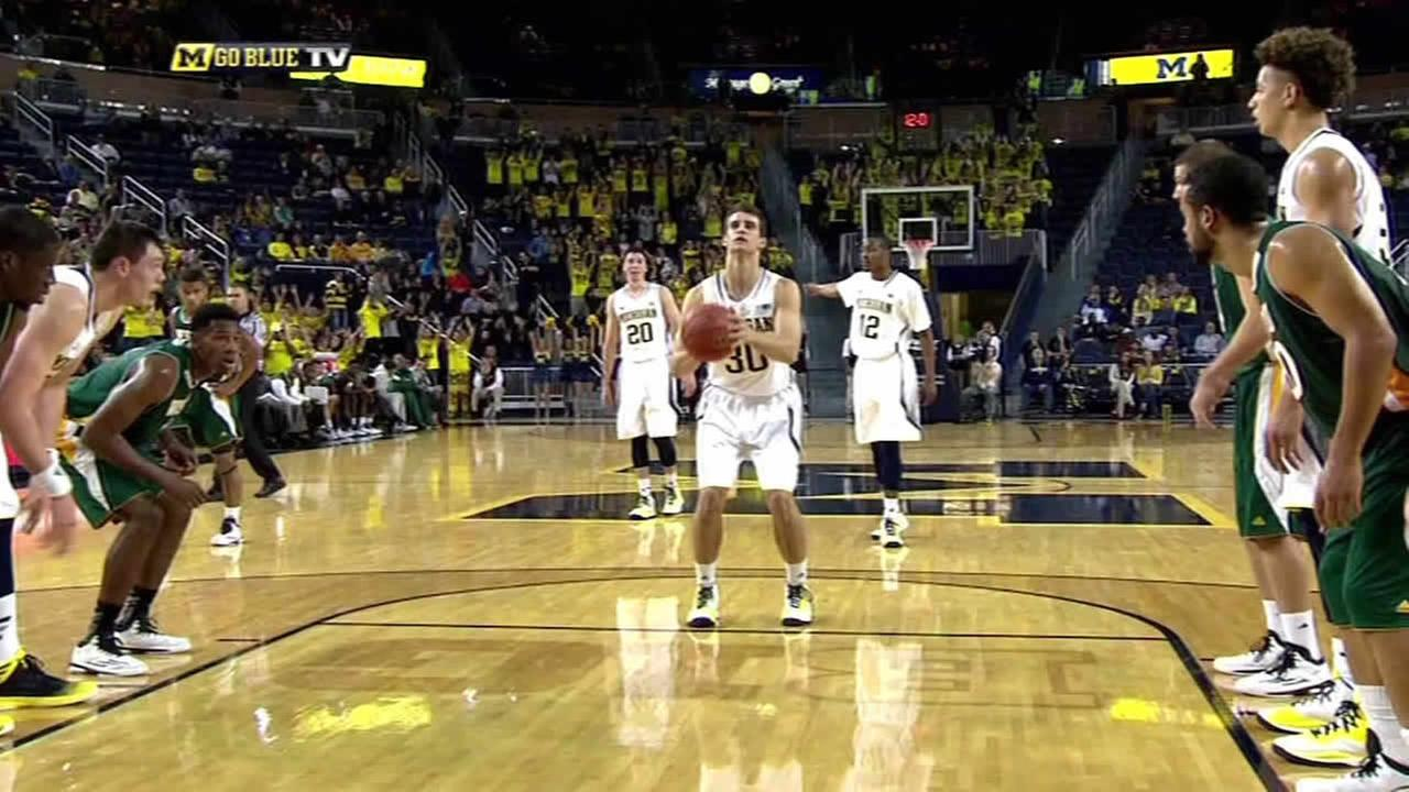 Michigan freshman Austin Hatch sinks his first college shot.