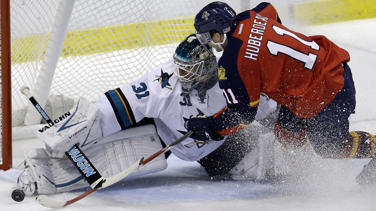 San Jose Sharks goalie Antti Niemi (31) stops the puck as Florida Panthers center Jonathan Huberdeau (11) attempts a shot on the goal in the third period of an NHL hockey game.