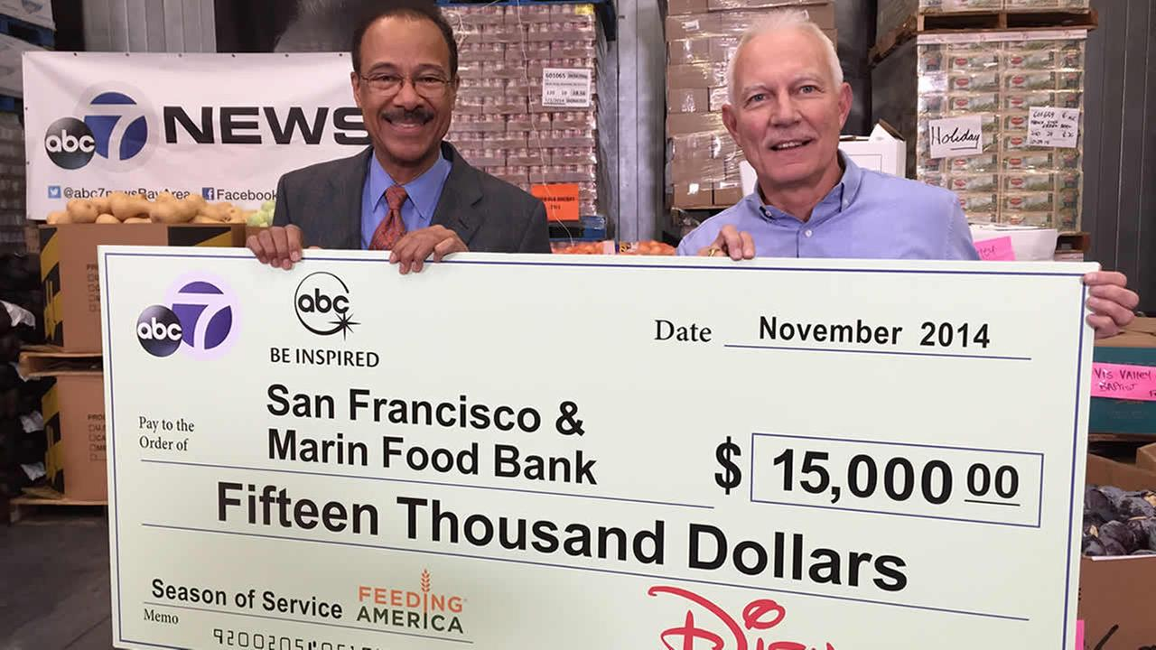 ABC7s Spencer Christian presents a check for $15,000 to the San Francisco-Marin Food Bank on behalf of ABC7 and our parent company Disney.