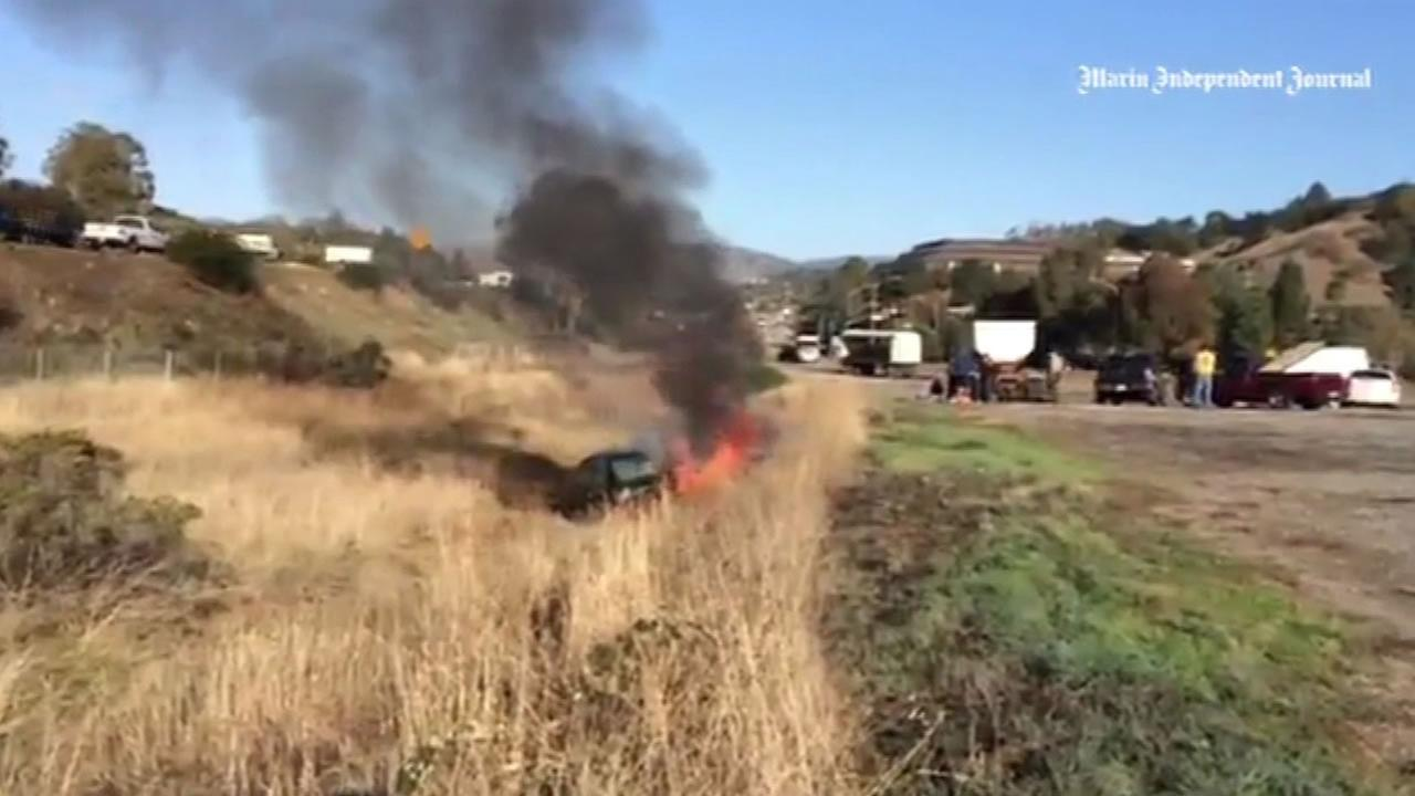 Car bursts into flames after crash in Marin County