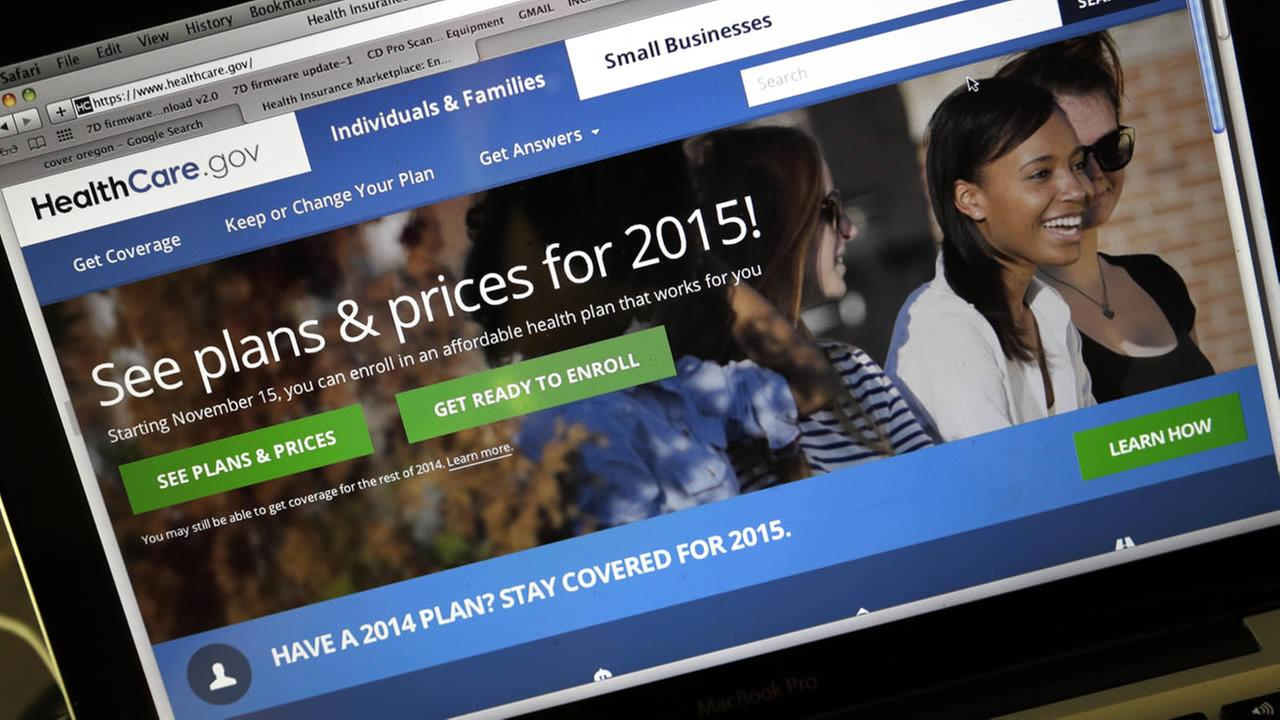 This Wednesday, Nov. 12, 2014 photo shows the HealthCare.gov website, where people can buy health insurance, on a laptop screen in Portland, Ore. (AP Photo/Don Ryan)