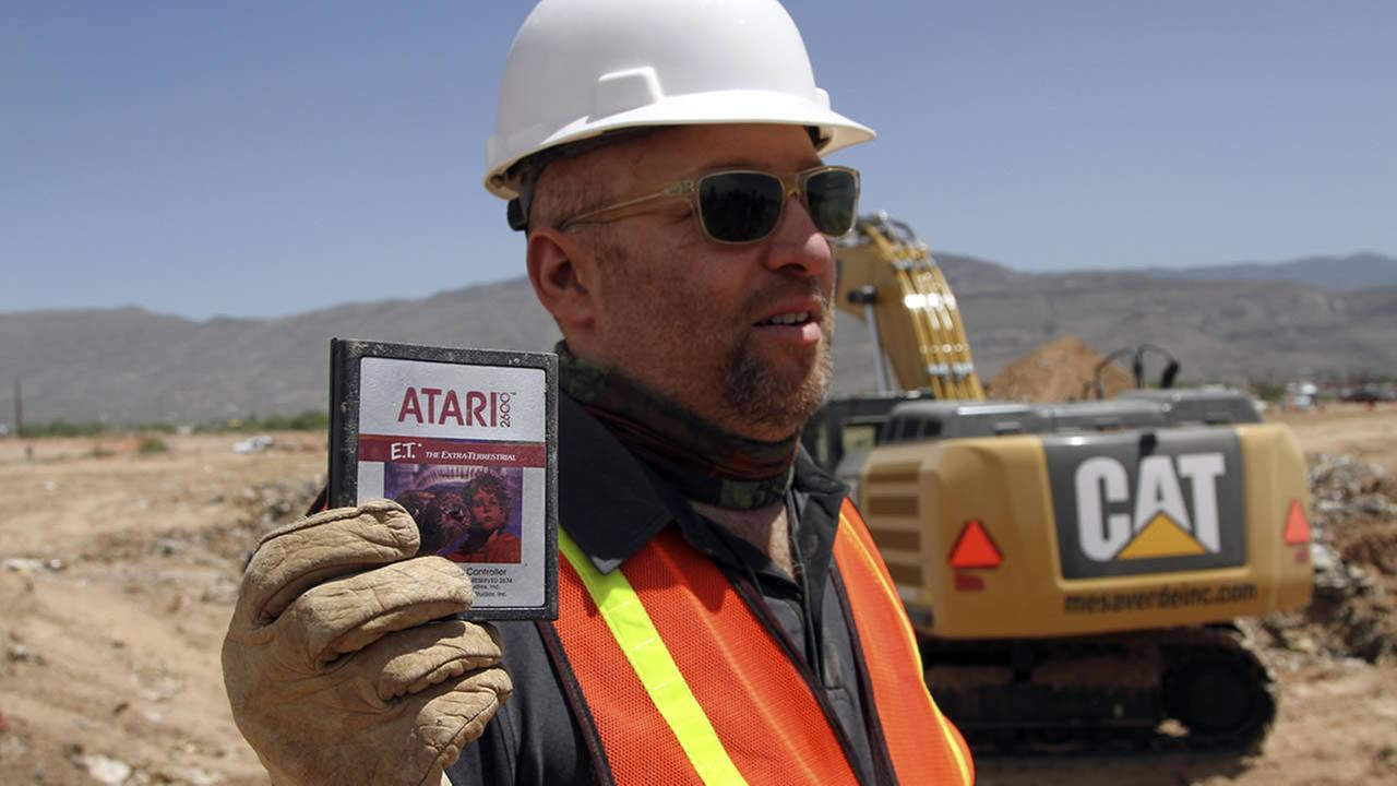 In this April 26, 2014 file photo, film Director Zak Penn shows a box of a decades-old Atari E.T. the Extra-Terrestrial game found in a dumpsite in Alamogordo, N.M. (AP Photo/Juan Carlos Llorca)