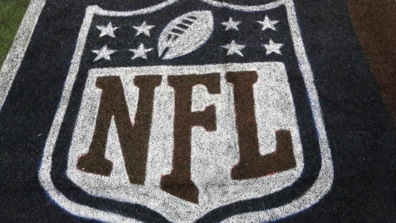 The NFL Logo is seen on the field before the first half of an NFL football game, Sunday, Sept. 7, 2014, in Arlington, Texas. (AP Photo/Mat Otero)