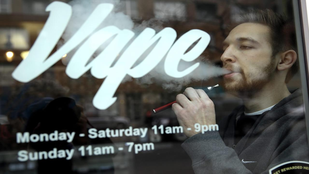 Eric Scheman demonstrates an e-cigarette at Vape store in Chicago, Wednesday, April 23, 2014. (AP Photo/Nam Y. Huh)